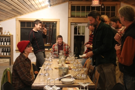 The assembled tasters discuss one of the samples.